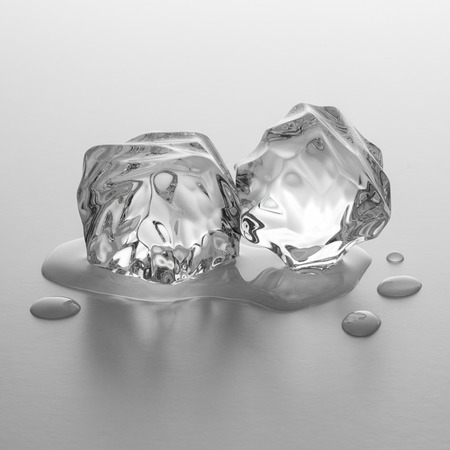 icecubes: Two ice cube rocks lie in melting water in gray gradient background