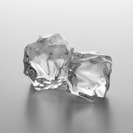 icecubes: Two clear nature ice chunks on gray gradient background