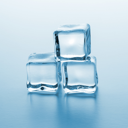 icecube: pile of cold clear ice cubes on gradient background Stock Photo