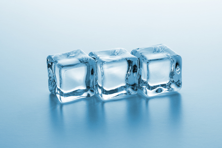 line of three clear ice cubes Stock Photo