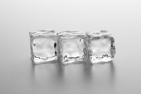 icecubes: row of Crystal clear ice cubes on gray gradient background