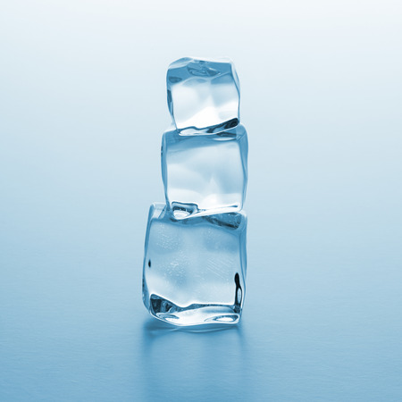 icecube: group of Crystal clear ice cubes as a tower on blue gradient background