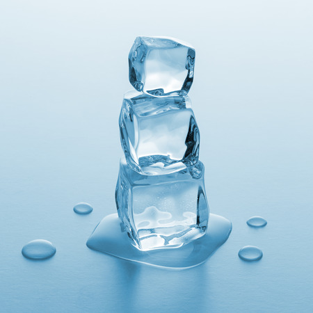 icecubes: tower of different melting ice cubes on blue gradient background