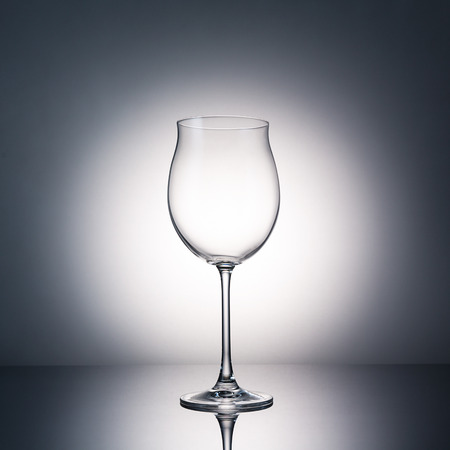 investigated: glass for wine on gray background Stock Photo