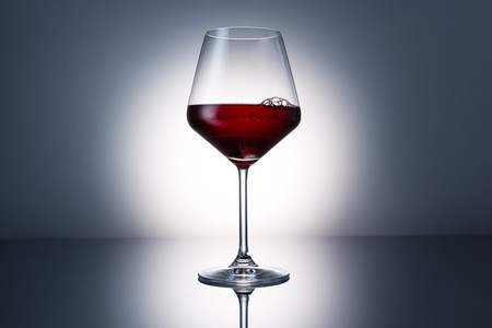 investigated: wine glass with red wine and dew drops Stock Photo
