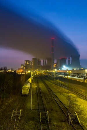 coal fired: power station in germany at sunset with freight depot