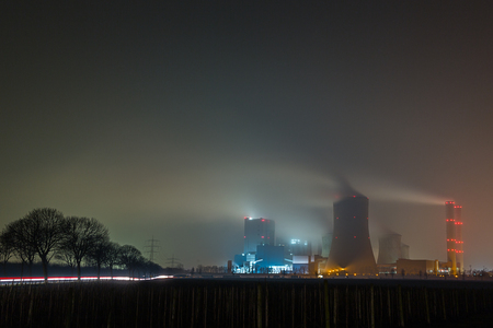 coal fired: power plant in germany on a foggy day at night Stock Photo