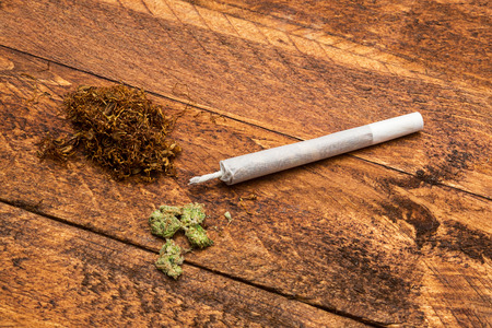 intoxicant: joint with marijuana pox and a heap of tobacco