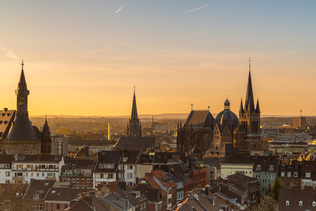 A view of the city skyline of Aachen with cathedral and town hall at morning sunset