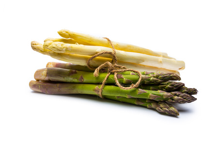 bundles: Two bundles of asparagus varieties isolated on white background