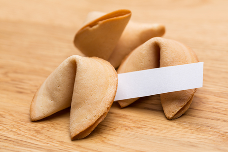 fortunately: A group of three fortune cookies with note on white background Stock Photo