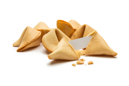 fortunately: A pile of fortune cookies with Note and crumbs isolated on white background