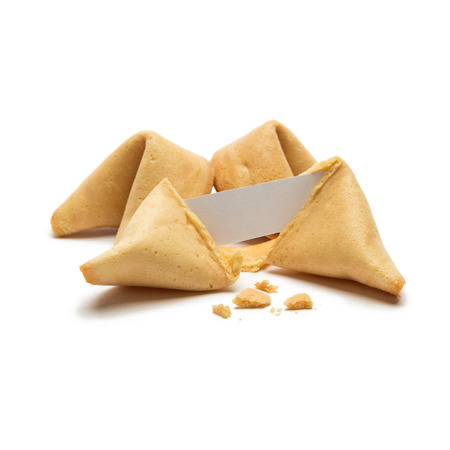 fortunately: A pile of fortune cookies with note isolated on white background