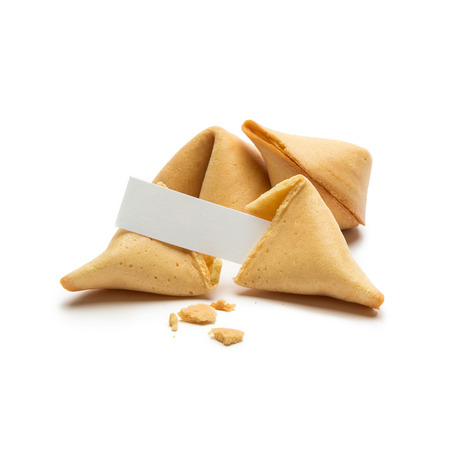 A Open fortune cookie with note isolated on white background