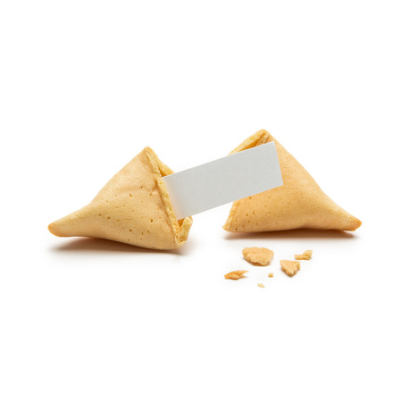 A single cracked fortune cookie with note and crumbs isolated on white background Stock Photo