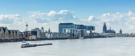 inland waterways: Cologne in Germany with crane houses and Cathedral at the Rhine river in Germany