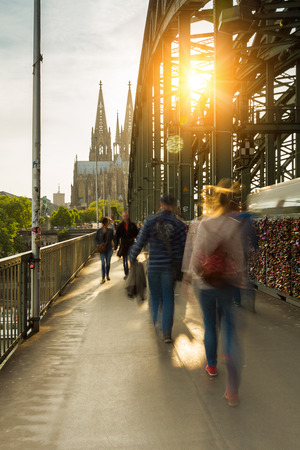 concluded: View of the Hohenzollern bridge with padlocks and cathedral in Germany at sunset