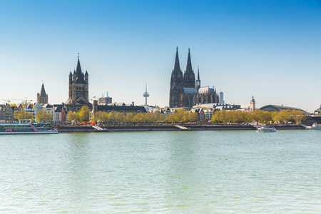 martin: Cologne Cathedral and Groos st. Martin at the Rhine river in Germany Stock Photo