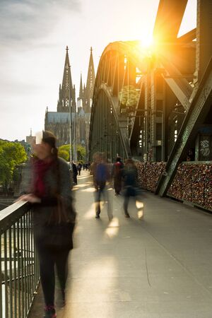 concluded: Hohenzollern bridge with padlocks and cathedral at sunset
