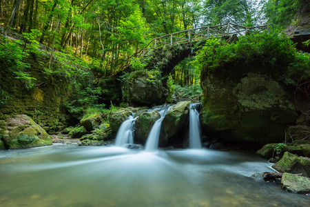 quiet: Cascading waterfall with pond deep in the woods