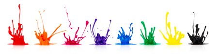 line of colorful paint splashes on white background Imagens