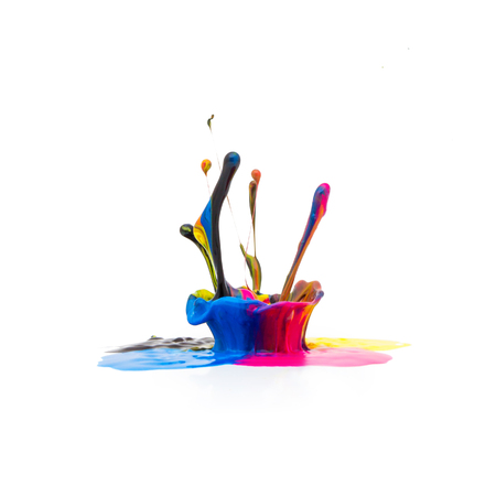 printing inks: splash of Colorful oil paint in CMYK colors on white