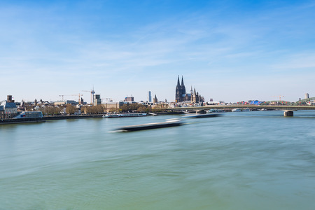 inland waterways: skyline view of cologne city in Germany at spring