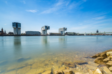 moorings: cologne city skyline with Crane Houses at the Rhine shore