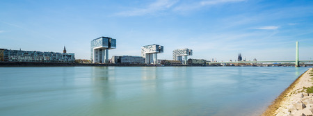 moorings: City of Cologne in Germany with Crane Houses at the Rhine shore
