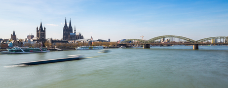 inland waterways: cologne city with cathedral and Hohenzollern bridge at spring Stock Photo