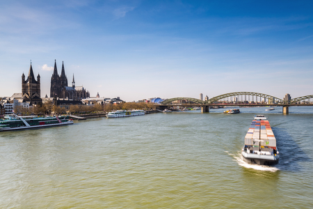 inland waterways: cologne at spring with Hohenzollern Bridge and Cathedral in Germany