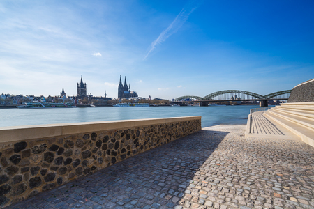 Rhine Boulevard in cologne deutz of the cathedral and Hohenzollern bridge at spring Foto de archivo