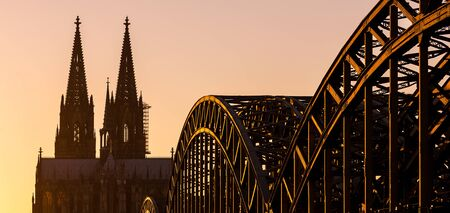 cologne: Cologne Cathedral and the Hohenzollern Bridge at sunset in cologne
