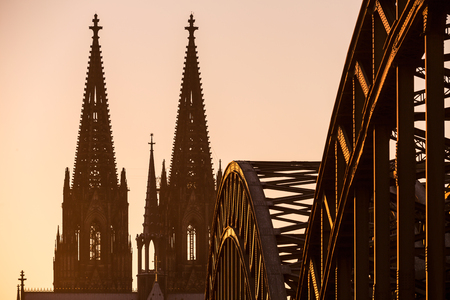 oldtown: Cologne Cathedral and the Hohenzollern Bridge tops at sunset in Germany