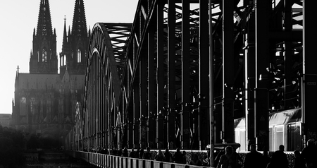 oldtown: Cathedral of Cologne and the Hohenzollern Bridge in black and white colors