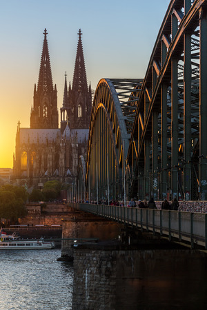 oldtown: Cologne Cathedral and the Hohenzollern Bridge at sunset in Germany at summer