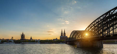 oldtown: ologne City Skyline with Cathedral and Hohenzollern Bridge at sunset