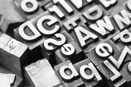 copywriter: Macro View of different old lead letters Stock Photo