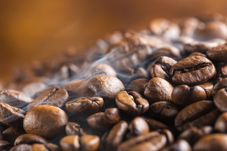 fragrant: Heap of hot coffee beans with smoke Stock Photo