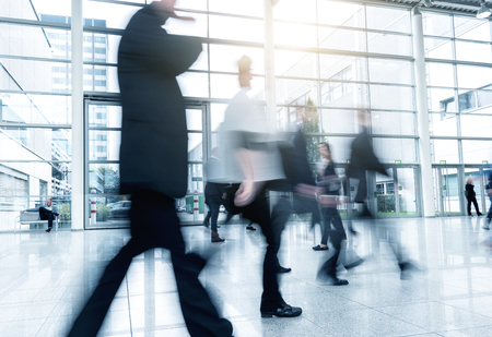 trade fair: Group of Business People walking at a Exhibition Stock Photo
