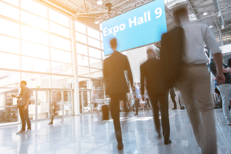 Blurred business people at a expo hall Stockfoto
