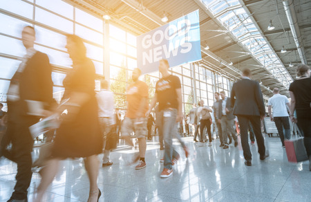Blurred business people at a trade show Stock Photo