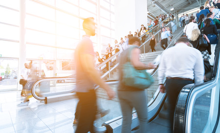 fairly: Blurred people on a fairly using a skywalk  staircase Stock Photo