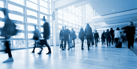 congress center: Abstract Image of People walking at a fair traid floor Stock Photo