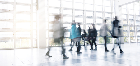messe: Abstract Image of People walking at a traid fair hall Stock Photo