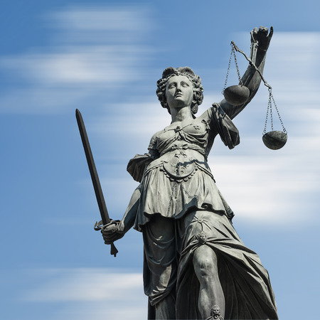 Statue of justice (Justice) against blue sky