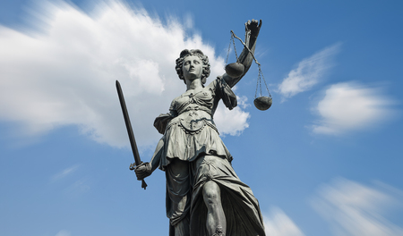 Statue of justice (Justice) on blue sky Stock Photo