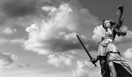 黒と白は曇り空で正義の女神 写真素材