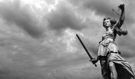 justitia: Statue of justice goddess (Justitia) with cloudy sky, Black and white Stock Photo