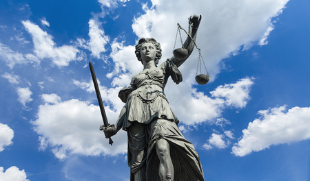 cloudy sky: Statue of Justitia (justice goddess) on cloudy blue sky
